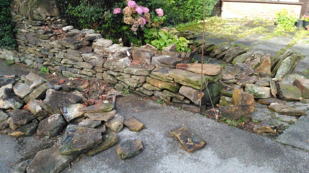 A dry stone repair in Longridge before pic.